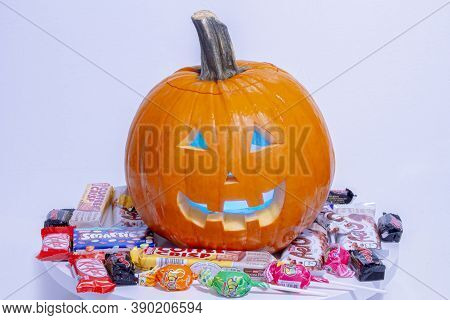 Calgary, Alberta, Canada. Oct 16, 2020. A Halloween Pumpkin Jack-o-lantern With Popular Halloween Ca