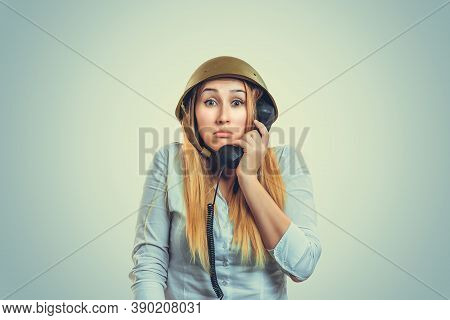 Woman In Military Armor Cap Helmet Of World War Ii Period Talking At Telephone Shrugging Shoulders I