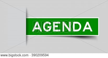 Inserted Green Color Label Sticker With Word Agenda On Gray Background