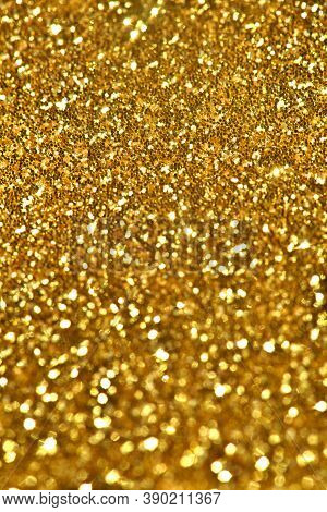 Golden Glitter Background For Holidays.golden Shining Yellow Gold Glitter Texture Background. Select