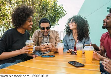Portrait Of Afro Friends Having Fun Together And Enjoying Good Time While Drinking Fresh Fruit Juice