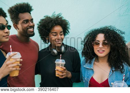 Portrait Of Multi-ethnic Group Of Friends Having Fun Together And Enjoying Good Time While Drinking
