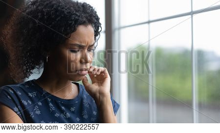 Unhappy Young Biracial Woman Feel Lonely Depressed At Home