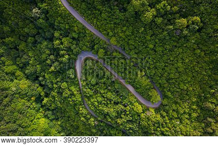Aerial View Of Countryside Road The Green Forrest And Mountain.