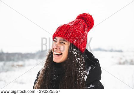 Portrait Of Young Pretty Woman In Red Hat With Bubo Smiling