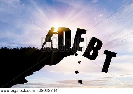 Eliminate Or Get Rid Of Debt Concept , Silhouette Man Pushed Off Debt Wording A Cliff With Blue Clou