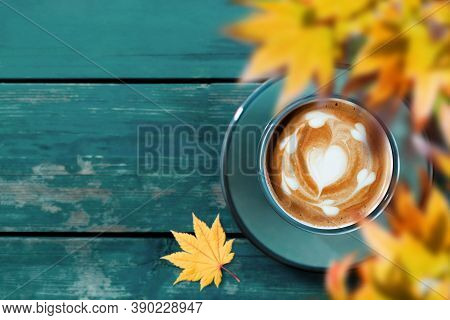Drinking Coffee In Fall And Autumn Season. Hot Coffee Latte Cup On Blue Wooden Table. Top View. Focu