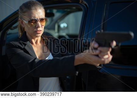 Special federal intelligence agent woman in black suit and big car