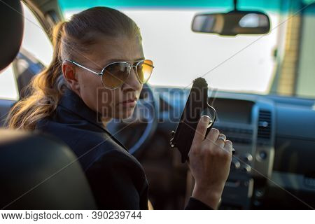 Special federal intelligence agent woman in black suit and big police car
