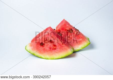 Watermelon On A White Background. Cut Off A Slice Of Watermelon. Red Ripe Watermelon