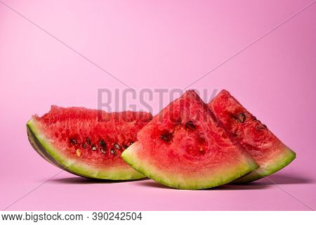 Watermelon On A Pink Background. Cut Off A Slice Of Watermelon. Red Ripe Watermelon