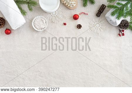 Christmas Spa Concept And Winter Skin Care Products, Fir Branches And Snowflakes On White Soft Towel