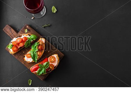 Bruschetta Sandwiches With Tomatoes, Cream Cheese, Grilled Paprika And Basil On Wooden Board, Top Vi
