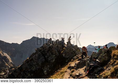 Tatra Mountains, Poland, 21/09/2020. Tourists Recklessly Taking Selfies With Selfie Sticks At The Ed
