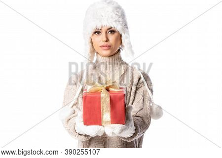 Christmas Happy Woman With Red Gift Box Wearing A Knitted Sweater And Winter Hat, Isolated Over Whit