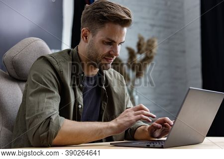 Young Freelancer Working In Home With Laptop. Texting Messages, Browsing Internet. Studying Online,