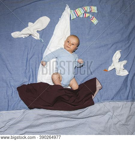Baby Boy In A Fairy Tale. Sailor On A Ship At Sea