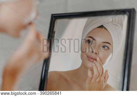 Healthy Woman Wears Minimal Makeup, Takes Care Of Complexion And Lips, Looks At Herself In Mirror, S
