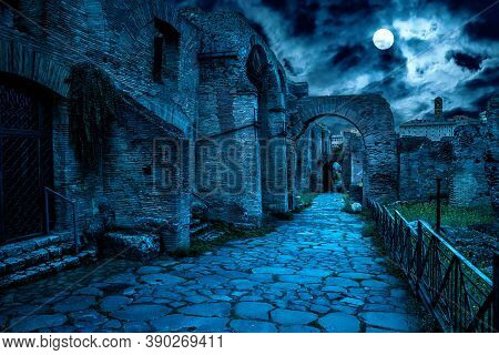 Roman Forum At Night, Rome, Italy. Mystery Creepy View Of Ancient Street In Full Moon. Spooky Dark S