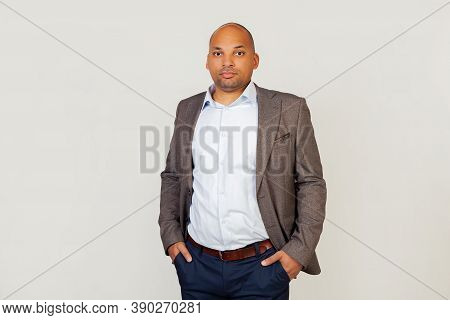 Young Male, African American Businessman Smiling, Looking Into The Camera, Holding His Hands In His