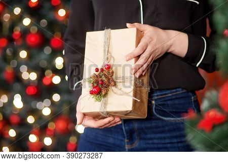 Female Hands Holding Gift Box. Christmas, Hew Year, Birthday Concept. Festive Background With Bokeh