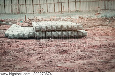 Pile Concrete Pillars On Ground In Construction Site