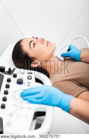 Ultrasound Diagnostics Of The Endocrine System And Thyroid For Woman. A Female Patient Receives Thyr
