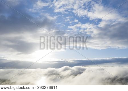 Aerial View Clouds Over The Forest. View From Drone. Aerial View Cloudscape. Texture Of Clouds. View