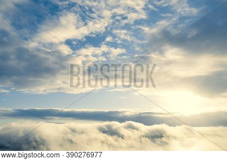Aerial View Clouds Over The Forest And Lake. View From Drone. Aerial View Cloudscape. Texture Of Clo