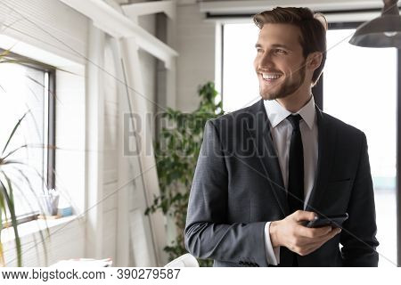 Happy Young Dreamy Ceo Manager Thinking Of Business Opportunity.