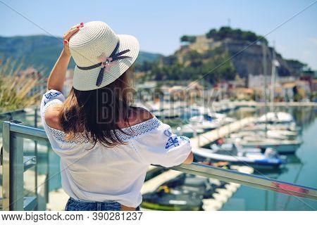 Rear View Woman Wear Hat Pose On Denia Castle Background. Spain