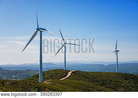 Turbines In A Mountain Wind Farm. Ecological Energy Production.