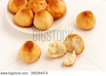 Crunchy Coconut Cookies On White Wooden Background.