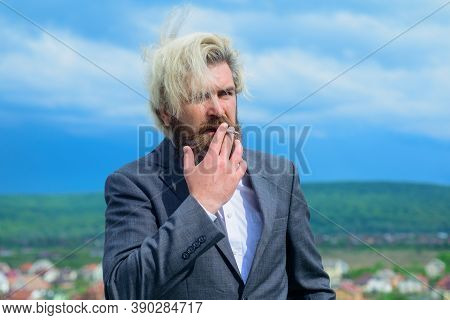 Sensual Bearded Man With Cigarette. Bearded Man Smoke The Cigarette. Stylish Hipster With Cigarette.