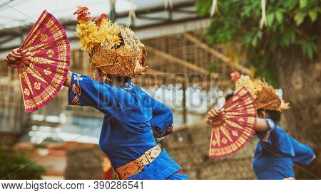 Asian Travel Background. Group Of Beautiful Balinese Dancer Women In Traditional Sarong Costumes Wit