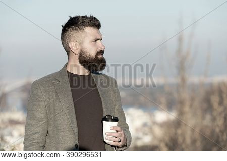 Caffeine Addicted. Hipster Hold Cup With Caffeine Energy Drink. Bearded Man Recharge With Hot Caffei