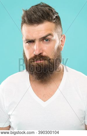 Beard Fashion And Barber Concept. Strict And Serious. Man Bearded Hipster Stylish Beard Turquoise Ba
