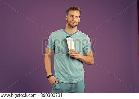 Liquid Soap. Cherishing My Skin. Man Cheerful Handsome Sportsman Hold Bottle Shampoo Shower Gel. Sha
