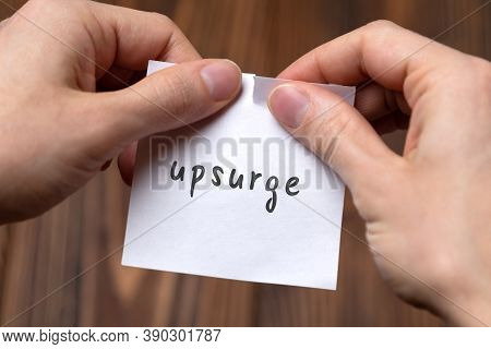 Cancelling Upsurge. Hands Tearing Of A Paper With Handwritten Inscription.