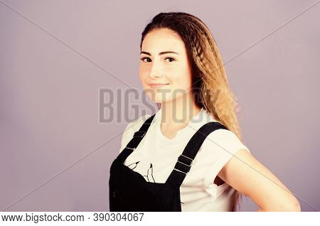Popular Look. Woman Smiling Face Posing With Stylish Hairstyle On Violet Background. Hair Crimping M