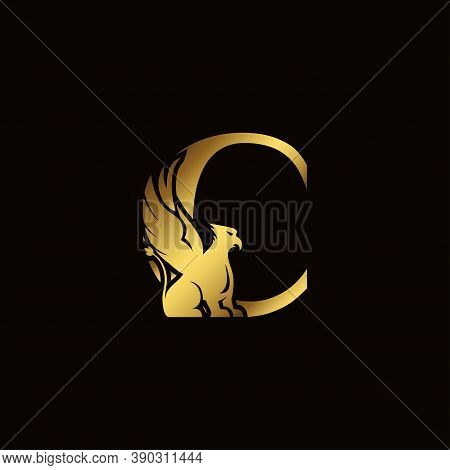 Griffin Silhouette Inside Gold Letter C. Heraldic Symbol Beast Ancient Mythology Or Fantasy. Creativ