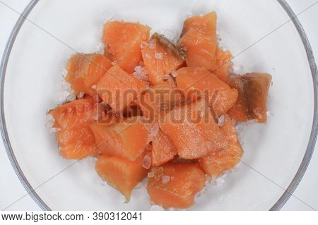 Pieces Of Salted Trout Fish With Salt. Close Up