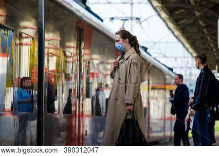 Moscow. Russia. October 4, 2020 A Young Woman Wearing A Protective Medical Mask Stands On The Platfo