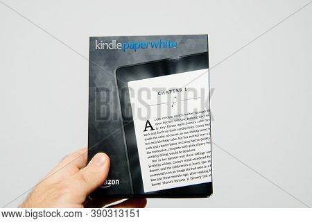 Paris, France - Mar 14, 2018: Male Hand Holding Package Of New Amazon Kindle Paperwhite Package Befo
