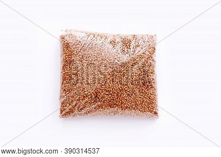 Buckwheat Groats In A Plastic Bag On White Background, Top View