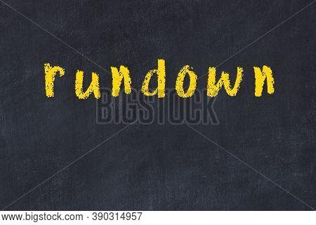 Chalk Handwritten Inscription Rundown On Black Desk