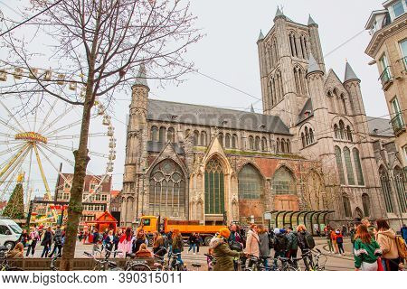 16 December 2019, Ghent, Belgium. Saint Nicholas Church, Christmas Market And Tourists On The Street