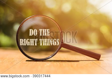 The Phrase Do The Right Things Typed On A Magnifier Glass. A Reminder To Make The Right Choices Acco