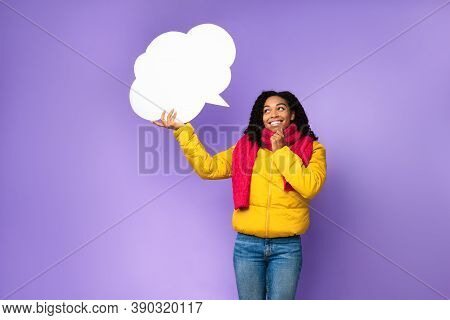 Cheerful Black Woman Holding Empty Speech Bubble Above Head Thinking Standing Posing Over Purple Stu