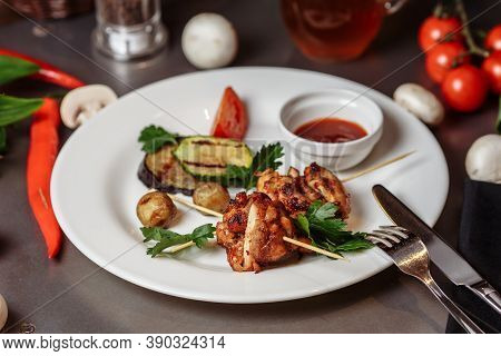 Barbecued Marinated Turkey Or Chicken Meat Shish Kebab Skewers With Ketchup Sauce And Grilled Vegeta